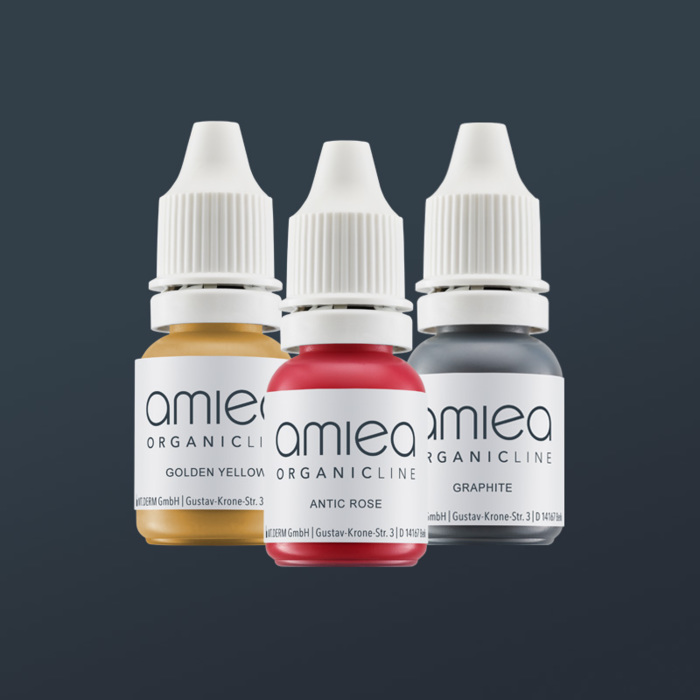 Three bottles of amiea organicline colors, on grey backg